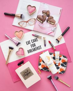Eat cake for breakfast flatlay. I love this perfume shaped handbag and too faced cosmetics heart shaped blusher. I also love this almond milk and honey products from the body shop.