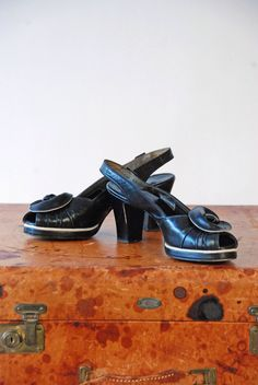Vintage 1940s Shoes - Smashing Buttery Black Leather Two Tone 40s Platforms with White Contrast, Peeptoe, Slingback and Rosette Size 8.5 by FabGabs on Etsy https://www.etsy.com/listing/495674228/vintage-1940s-shoes-smashing-buttery