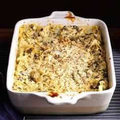 Artichoke Spinach Lasagna - olive oil, onions, mushrooms, garlic, veg broth, artichoke hearts, spinach, rosemary, nutmeg, pepper, Alfredo sauce, lasagna noodles, mozzarella cheese, tomato & basil feta cheese, oregano, parsley and basil. On serving equals 269 calories.