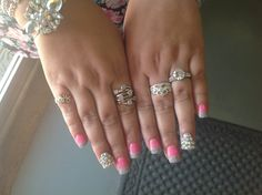 Pink and silver with bling acrylic nails by Nikki.