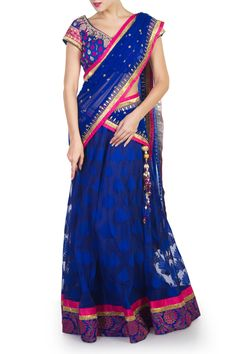 An elegant royal blue Banaras jacquard lehenga with a brocade border on the hem line. Paired with a blue and pink brocade choli and blue net dupatta.  Royal blue is a must have colour this season and apt for an evening function.