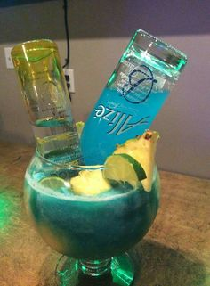 Mmmmm yes please! BLUE PARADISE- Pineapple Ciroc, blue Alize, Dole frozen juice (pineapple orange banana), sweet & sour mix, Monster blue energy drink