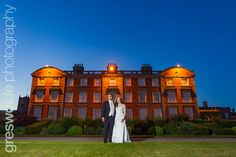 Bride and Groom outside the Hall at Weston Park in the evening Weston Park, The Outsiders, Groom, Louvre, Wedding Photography, Bride, Mansions, House Styles, Building