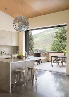 Kimberly Gavin Photography  URL     http://beckbuilds.com   Amazing kitchen with outdoor access.