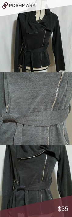 Stunning Boutique jacket Zinger up closure on 1 side, 2 pockets zip up closure.  All zippers are silver.  Fabric stretches, stunning neckline,  ties around the front with removable tie.  Grey with slight stripe.   No size tag on the inside.  Size Small.  Bought at a boutique in Sedona Arizona.   Smoke-free home Boutique  Jackets & Coats