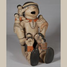 Male Storytelling Doll: Helen Cordero is certainly accepted as the most innovative potter at Cochiti Pueblo.  From a complete failure at making traditional pottery vessels she blossomed at making figurine pottery, particularly storyteller figurines.