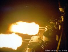5-inch guns of the battleship USS Missouri (BB-63) firing at night, World War II.