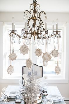 """The Farmhouse Holiday Decor Series is back and today I'm sharing a winter tablescape. I'm not quite ready to break out the Christmas decorations, especially since I use a lot of fresh greenery, but I like the idea of a festive winter table to fill in that decorating gap. This week's """"theme"""", a holiday/Christmas tablescape, was sponsored …"""