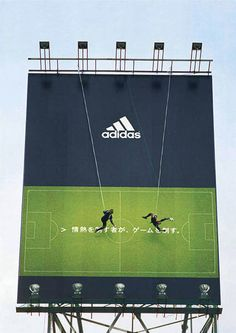 Billboard in Japan.  Real people playing vertical soccer.  See YouTube or the video!