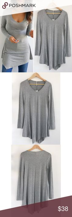 """Gray Long Sleeve Top Gray Long Sleeve Top! Super comfortable and stretchy. Perfect basic piece for inside in the winter. New with tags. Rayon Spandex blend. Chest-35"""" length-32"""" sleeves-24"""" Tops Tees - Long Sleeve"""