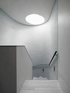 A curved skylight fills the central part of the house with light, while keeping the stairs bright.