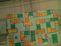 """This is a hand made gameboard. Manila folder little colored cut outs that were glued in place then laminated. The goal is to make so many spaces to show and mark positive behaviors before the reward(rectangled area). As the spaces get filled the rewards are leading to the most wanted reward that has been written in. The length of this game could be anywhere between hours or days depending on the child. There is an """"oops"""" card that can be used for oops times. Goal=child to catch own mistakes."""