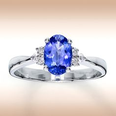 Tanzanite ring with side diamonds. 7.5x5.5mm center stone. Simple and pretty.