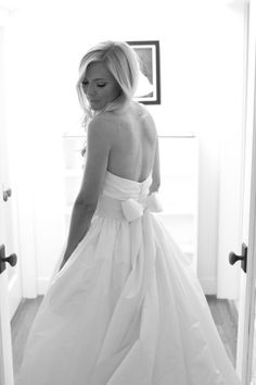 Here is how i would change this into perfection... same material, strapless, sweetheart neckline, dropped waste withe the bow. Simple, no glitz. Just glamorous