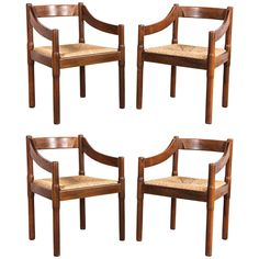 Set of Four Carimate Dining Chairs by Vico Magistretti for Cassina | From a unique collection of antique and modern dining room chairs at https://www.1stdibs.com/furniture/seating/dining-room-chairs/