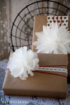 This is amazing!  Beautiful neutral gift wrap ideas with a wax paper flower tutorial from Whipper Berry! SO doing something like this for Christmas this year!!