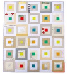 "Rita calls this ""A Neutral Study Quilt"".  As I am trying to figure out why I like it so much, it occurs to me that it is the big red polka dot fabric that gives it pizzaz and the complementary red and green/teal that gives it balance."