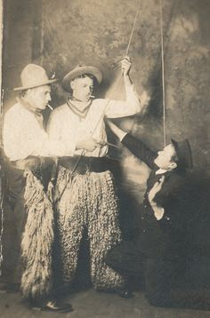 """One of the fun """"drama"""" photos in our collection, a staged image of outlaws holding up a trainmaster. Herb Bergman, John Daniels, and Hy. Masemann, undated."""