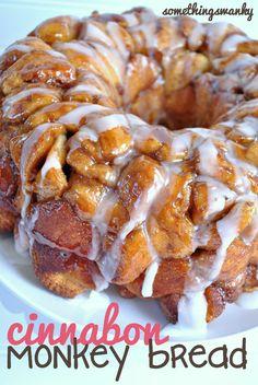 dough,  1 c. sugar , 1 tbsp. cinnamon.  melt 1/2 c. butter,  1/2 c. brown sugar.  bake 400 degrees 20 minutes, cool 15 then flip