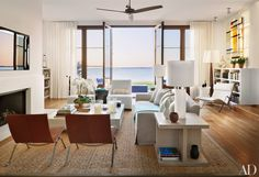 French Doors open out on to the beach from a living room with a relaxed, comfortable interior