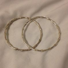 Silver bangles Beautiful 2 Silver bangles for sale! These are so pretty and have remained gorgeous and shiny since I've owned them! I wear a 3 inch bangle as these fit my wrist perfectly for those of us that need a little bigger bangle!  None Jewelry Bracelets