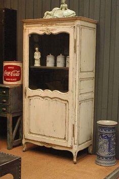 Distressed off white creamy ivory French cabinet