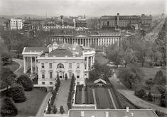 """1914. """"White House tent in Rose Garden."""" A view of the executive mansion from over the West Wing looking east past the Treasury and along Pennsylvania Avenue to the Capitol."""