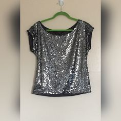 FLASH SALE Express - gunmetal gray sequin top EUC (it's my sister's and I'm actually not sure that she ever even wore it). Size XS but is boxy so it could fit S/M as well I think, but it would be a bit more cropped-looking especially if you have a long torso/big boobs. Perfect for New Years or other holiday parties! No trades, offers considered. Express Tops