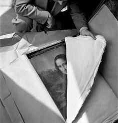 Mona Lisa being unwrapped after WWI