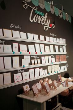 Love the dark wall in the craft show booth to make the white cards stand out. Signage written on the wall is effective too.