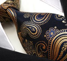 """Product number: PA-5757 Length: 59"""" Width: 3.5"""" Material: 100% Silk Care: Dry Clean Only Label: GENTLEMAN JOE This shimmering navy, gold, bronze, copper paisley tie is truly a work of art! Every angle"""
