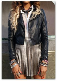 tough school girl look= Black Leather Jacket, white button down, silver pleated skirt, tons of chunky jewelry