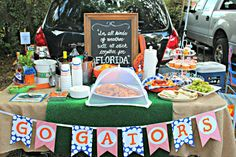 tailgating tablescape with bunting....but change those awful colors!!!! ick!!