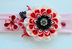 white and red ribbon flower