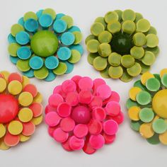 Mod Vintage enamel flower brooches http://www.flickr.com/photos/jennski/6172365161/in/pool-1220407@N20