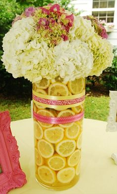 maybe red blood oranges with red roses, red silver ribbons,.................centerpiece - switch the pink out with another color. I love the yellow