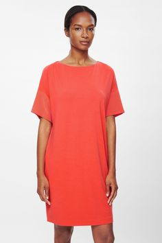 Made from soft, fluid jersey, this dress has contrast silk cuffs which have elegant folds on each side. A pull-on style, it is a loose straight shape with a wide round neckline, dropped shoulder seams and two subtle side pockets.