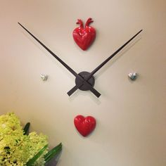 """We paired our NeXtime """"Hands"""" clock with our 27-CRUSH hearts to make a cool and unique clock and piece of wall decor!"""