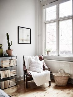 small bedroom corner chair near window