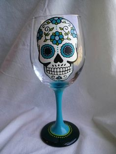 This listing is for 1 hand painted wine glass. It has a sugar skull painted on the front, outlined in black, filled with white, and detail work