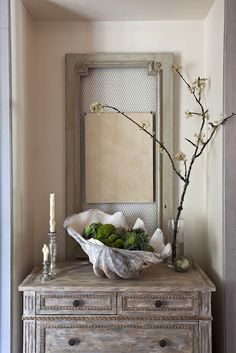 With existing porcelain shell, magnolia cones, and moss balls. Mirror instead of frame