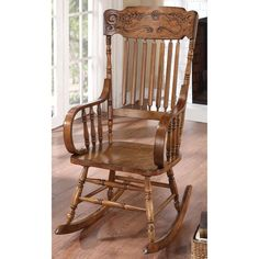 This Pavillion Windsor elegant design rocking chair features a solid wood construction, including supportive spindles and a contoured wood seat for supreme comfort.