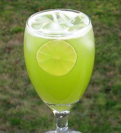 Mountain Dew Me (2 oz. Melon Liqueur 1 oz. Triple Sec 4 oz. Pineapple Juice 1 oz. 7-Up Lime wheel for garnish)