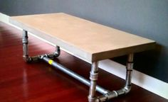 pipe leg coffee table. Industrial, but stained wood would make it warm.  Plus you can paint the pipes