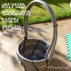 Upcycled garden hose into basket. What a great way of turning a throw away item into something attractive and useful!