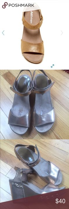 Antelope Metallic Wedge  Sandal Antelope Metallic wedge sandal. Fashionable  and comfortable. Velcro wrap around sling. In good condition. Has sticky residual from previous inserts in the instep. Otherwise great shoe! Antelope Shoes Wedges