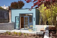 A Freestanding Garage Becomes a Light-Filled Painting Studio - Design Milk