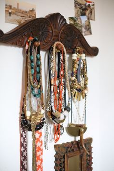 love jewelry, especially big necklaces. This wooden hanger is on the wall in my bedroom, and is a flea market find. My favorite necklace that I wear all the time is by Lizzie Fortunato. (See Lizzie's sneak peek here) I love how travel inspires their design.