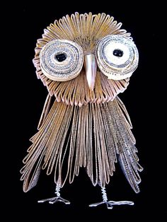 Wise old recycled owl he lives on an old dictionary on my desk