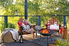 Outdoor Heating Ideas: Warm the winter deck to enjoy it in cooler weather. Add a fire pit, throws and lanterns. | Handyman Magazine #DIY #deck #firepit